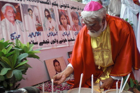 Bishop Coutts Lighting Candles for Victims of Persecution